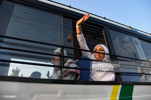 Kashmiri Muslim pilgrim waives hand as they depart for the annual Hajj pilgrimage to Mecca in Srinagar The first batch of 304 Kashmiri Muslim hajj...