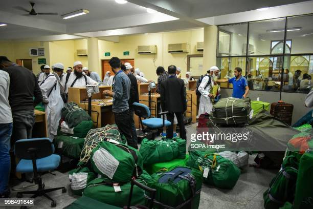 Kashmiri Muslim pilgrims collect their luggage ahead of departure to the Holy city of Mecca at hajj house in Srinagar Indian administered Kashmir The...