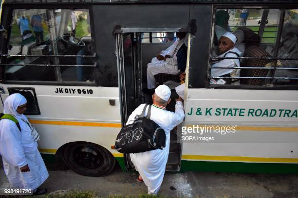 Kashmiri Muslim pilgrims get on a bus as they leave for the annual hajj pilgrimage to the holy city of Mecca in Srinagar Indian administered Kashmir...