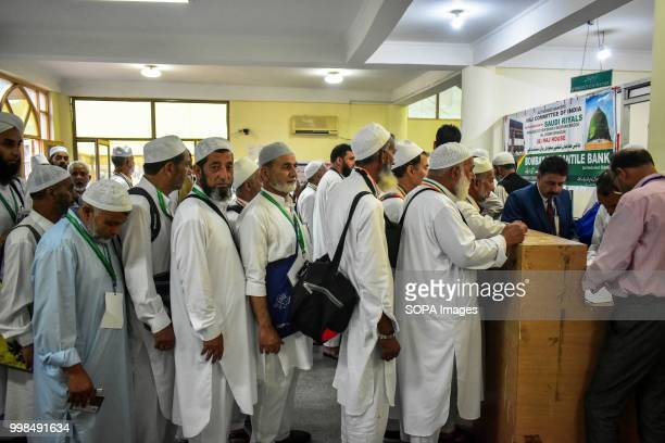 Kashmiri Muslim pilgrims stand in a queue to collect documents at hajj house in Srinagar, Indian administered Kashmir. The first batch of 820...