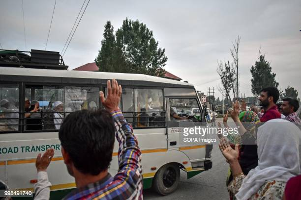 Kashmiri Muslim pilgrims wave to their relatives before leaving for the annual hajj pilgrimage to the holy city of Mecca in Srinagar Indian...