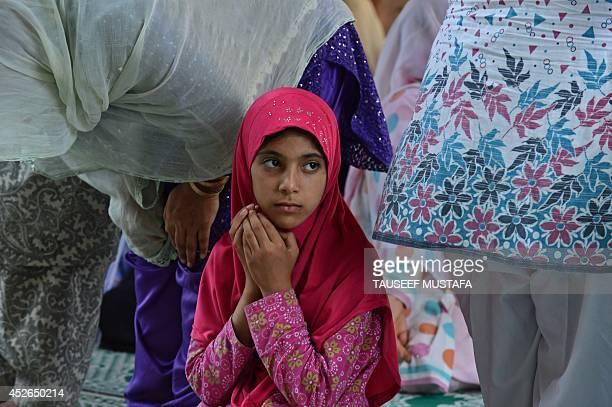 A Kashmiri Muslim prays during JummatulVida the last congregational Friday prayers in the holy month of Ramadan at the ShahiHamdaan shrine in...