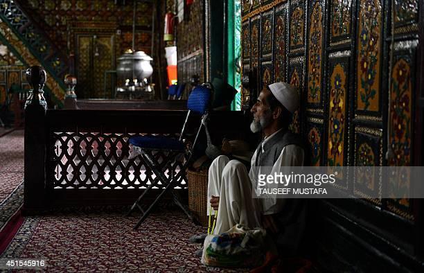 A Kashmiri Muslim prays during the holy month of Ramadan at the ShahiHamdaan shrine in Srinagar on July 1 2014 Across the Muslim world the faithful...