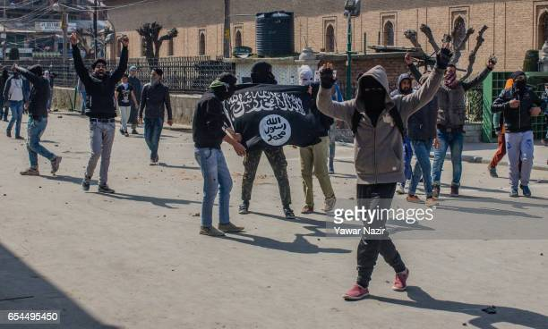 Kashmiri Muslim protester hold an ISIS flag as they chant anti Indian slogans during a protest against recent civilian killings by Indian forces on...
