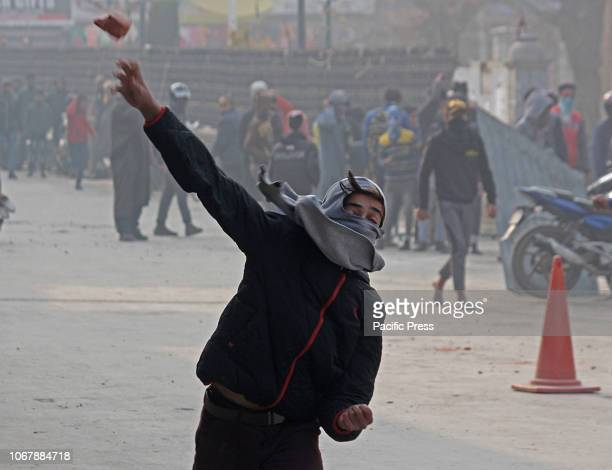 Kashmiri Muslim protester hurls a brick at Indian police in old city Srinagar the summer capital of Indian controlled Kashmir Minor clashes erupt in...