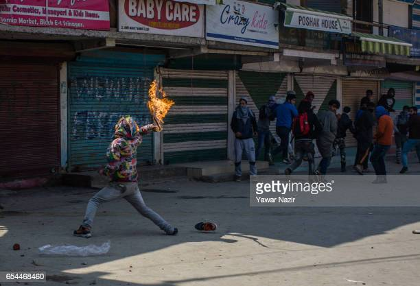 Kashmiri Muslim protester hurls Molotov cocktail towards Indian government during a protest against recent civilian killings by Indian forces on...