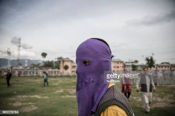A Kashmiri Muslim protester looks upon during the funeral procession of a civilian Adil Ahmed Saturday May 5 in Srinagar Indiancontrolled Kashmir...