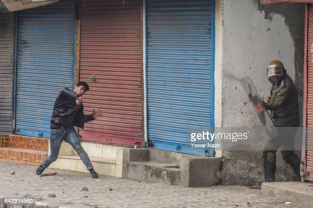 Kashmiri Muslim protester throw stones at Indian police officer during an anti India protest on February 17 2017 in Srinagar the summer capital of...