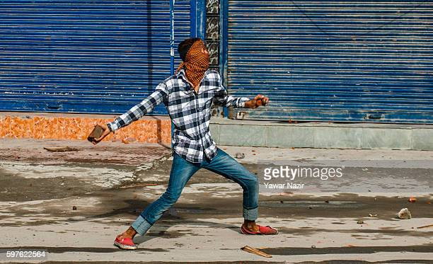 Kashmiri Muslim protester throws stones at Indian government forces during an antiIndia protest following weeks of violence that has left over 70...