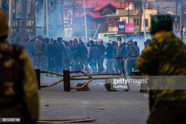 Kashmiri Muslim protesters and Indian government forces clash during the the funeral of Eesa Fazili a Kashmiri rebel who was killed in a brief...