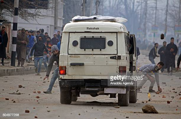 Kashmiri Muslim protesters clash with Indian security personnel during clashes after a college student found dead near railway tracks in Srinagar on...