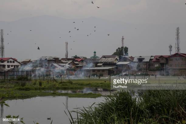 Kashmiri Muslim protesters clash with the government forces near the gunfight site Saturday May 5 in Srinagar Indiancontrolled Kashmir Three rebels...