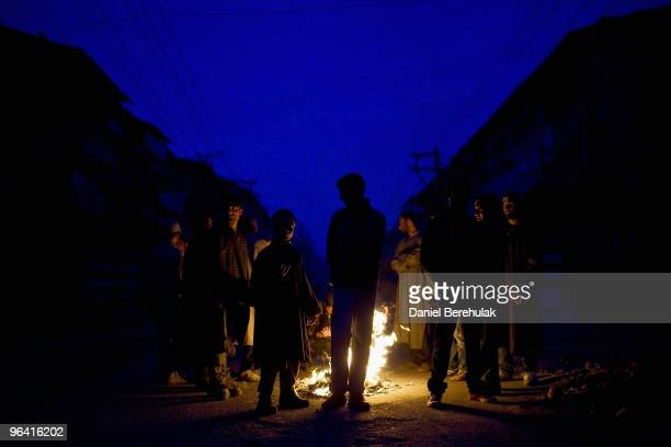 Kashmiri muslim protesters defying curfew gather around a fire before throwing stones towards Indian police during a protest on February 04 2010 in...