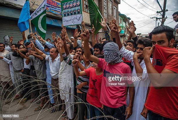 Kashmiri Muslim protesters hold flags shout anti Indian and pro Kashmir freedom slogans during an anti Indian protest following violence that has...