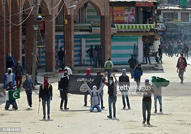 Kashmiri Muslim protesters hold Pakistani and ISIL flags as they shout antiIndia slogans during clashes in downtown Srinagar on April 82016 Police...