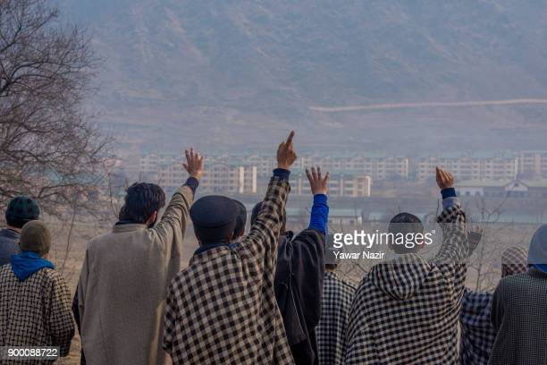 Kashmiri Muslim protesters shout pro Kashmir freedom slogans as they look towards the camp Kashmiri Muslim rebels on December 31 2017 in Barsoo south...