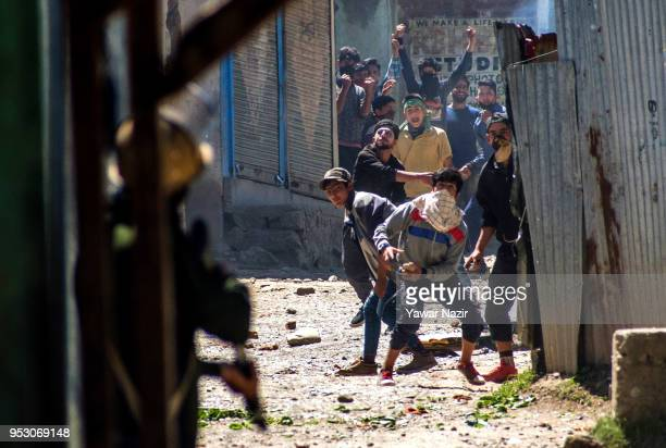 Kashmiri Muslim protesters throw stones at Indian armed forces near the site of gun battle between Indian armed forces and Kashmiri rebels on April...