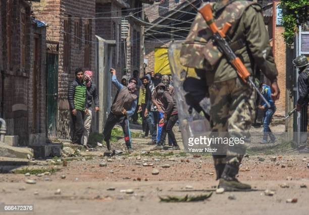 Kashmiri Muslim protesters throw stones at Indian government forces during an antielection protest over the elections of the lower house of Indian...