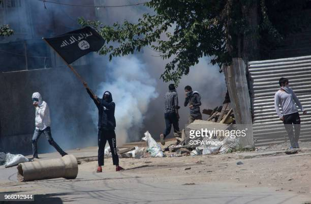 Kashmiri Muslim protestor waves ISIS flag during a funeral procession of a Kashmiri civilian Kaiser Amin Bhat in Sinagar the summer capital of Indian...