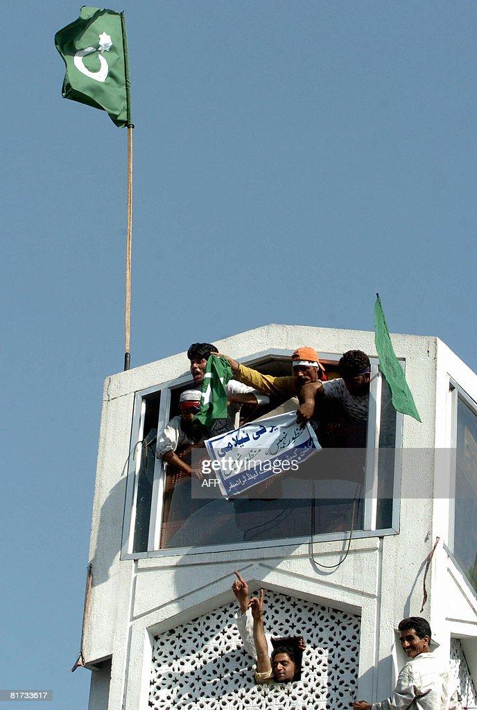 Kashmiri Muslim Protestors Hoist A Pakis News Photo