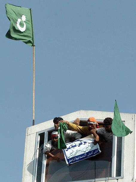 Kashmiri Muslim Protestors Hoist A Pakis