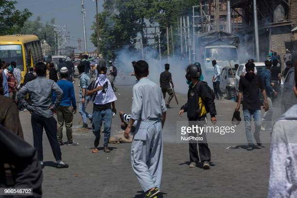 Kashmiri Muslim protestors throws stone at Indian Government forces during a funeral procession of a Kashmiri civilian Kaiser Amin Bhat on June 2 in...