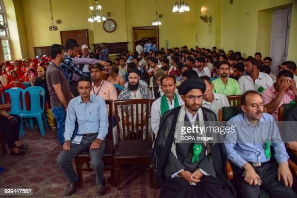 SONWAR SRINAGAR JAMMU KASHMIR INDIA Kashmiri Muslim sit for a mass marriage event in Srinagar Indian controlled Kashmir on Sunday Mass wedding of 105...
