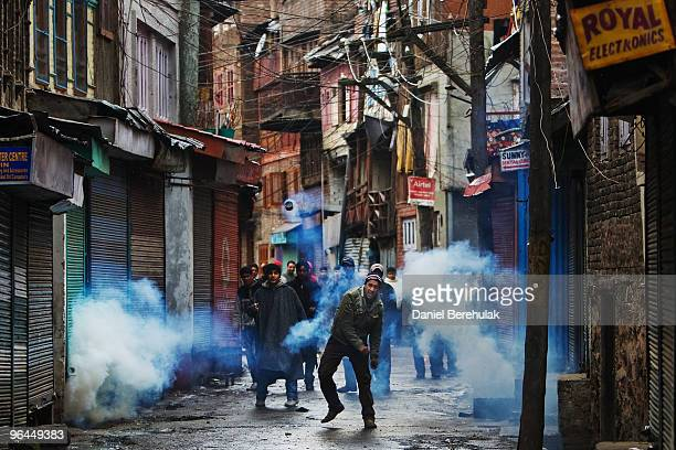 Kashmiri muslim throws back a can of tear gas shot by Indian police on February 05 2010 in Srinagar Kashmir India Fresh protests erupted today...