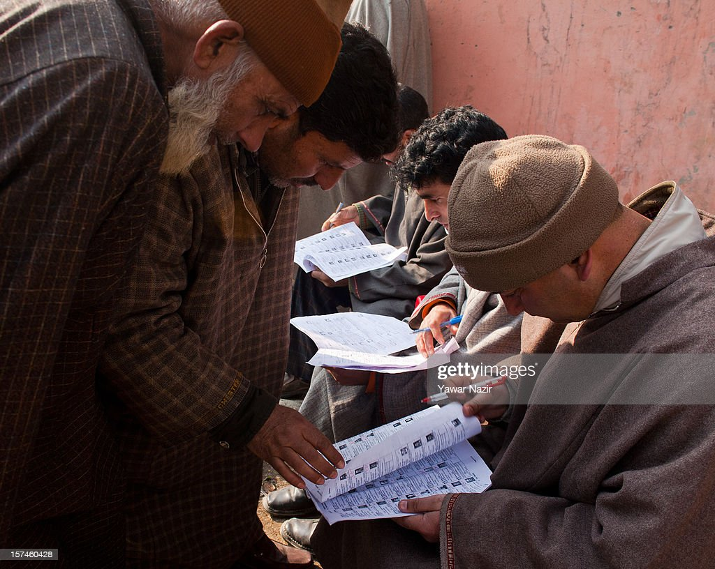 Kashmiri Muslim village heads search their names in election papers before casting their votes during state's legislative council election on December 03, 2012 in Budgam, west of Srinagar, Indian Administered Kashmir. Village heads in Indian-administered Kashmir voted for their representatives in the state's legislative council after 38 years today. These grass root workers are represented by four people in the council- the lower house of Kashmir assembly. This year the village heads were attacked by unidentified gunmen in the conflict torn region. Many resigned from their post after at least 10 village heads were killed in attacks. Today's polling saw long queues despite the resistance leadership calling for a boycott. But the biggest militant group in the region- the Hizbul Mujahideen- had refrained from calling a boycott saying the polling was necessary for daily administration of the state.