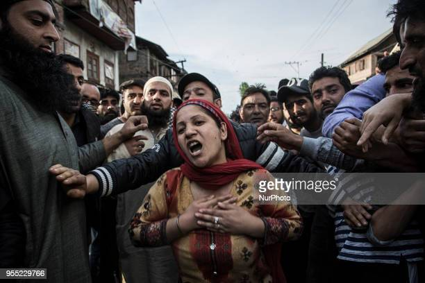 A Kashmiri Muslim woman cries during the funeral procession of a local rebel Fayaz Ahmed Hamal Saturday May 5 in Srinagar Indiancontrolled Kashmir...