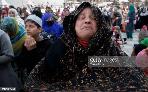 Kashmiri Muslim woman devotee prays at Hazratbal shrine to mark the anniversary of Hazrat Abu Bakr Siddiq the senior companion and the fatherinlaw of...