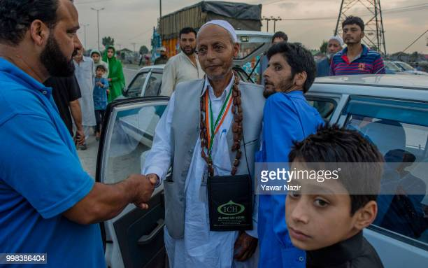 Kashmiri Muslim woman Hajj pilgrim wearing garland of dates raisin and cadmium as he departs for the annual Hajj pilgrimage to Mecca on July 14 2018...