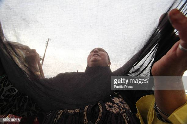 Kashmiri Muslim woman prays as a head priest displays the relic believed to be the hair from the beard of the Prophet Mohammad during special prayers...