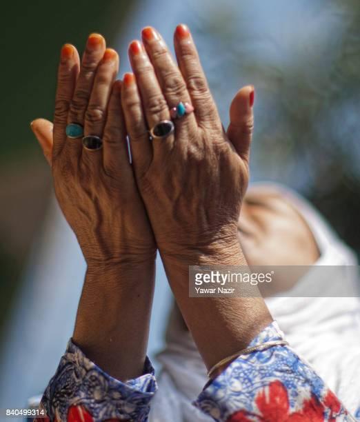 Kashmiri Muslim woman prays at the shrine of Khaniqahi mullah during a festival on August 29 2017 in Srinagar the summer capital of Indian...