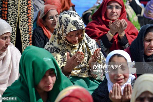 Kashmiri Muslim woman prays during a festival to mark the death anniversary of Abu bakr one of the companions of Prophet Muhammad at the Hazratbal...