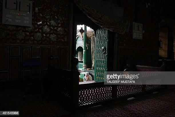 A Kashmiri Muslim woman prays during the holy month of Ramadan at the ShahiHamdaan shrine in Srinagar on July 1 2014 Across the Muslim world the...