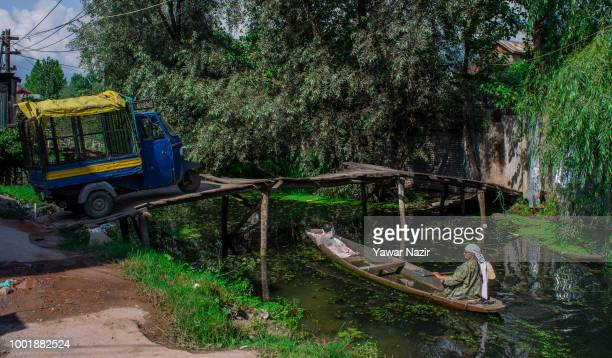 Kashmiri Muslim woman rows her boat on Dal lake on July 19 2018 in Srinagar the summer capital of Indian administered Kashmir India Kashmir the...