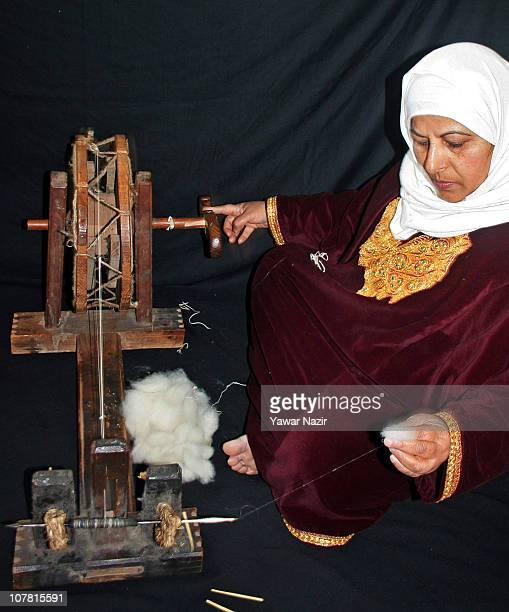 Kashmiri Muslim woman spins pashmina on a wheel used in shawl making December 29 2010 in Srinagar the summer capital of Indian administered Kashmir...