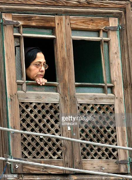 Kashmiri Muslim woman watches from the window of her house a clash between protestors and police in downtown Srinagar 11 February 2007 Violent...