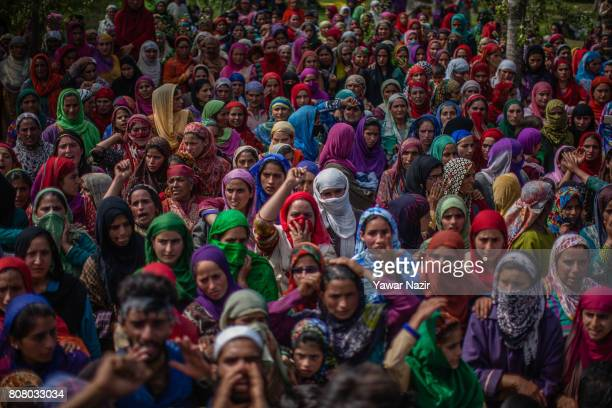 Kashmiri Muslim women attend the funeral of Jahangir Khanday a Kashmiri rebel killed in a gun battle with Indian government forces on July 4 2017 in...