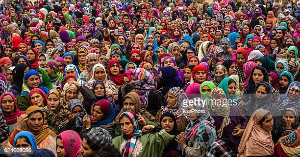 Kashmiri Muslim women attend the funeral of Rayees Ahmad a militant who was killed in a gun battle with the Indian government forces during his...
