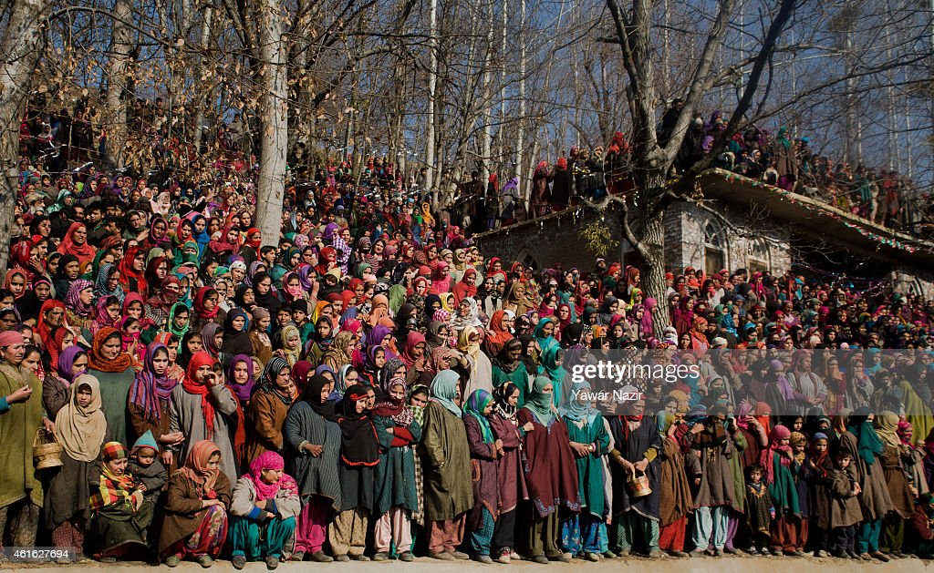 Kashmiri Muslim women attend the funeral procession of one of the five militants killed in a gun battle with Indian government forces on January 16, 2015 in Aglaar, 60 km (37 miles ) south of Srinagar, the summer capital of Indian administered Kashmir, India.Thousands of Kashmiri Muslims attended the funeral procession of five militants killed on Thursday during a gun battle with Indian government forces. The five Jaish-e-Muhammad militants were killed in a gunbattle which erupted in a forest in south Kashmir's Shupain district on Thursday, police said.