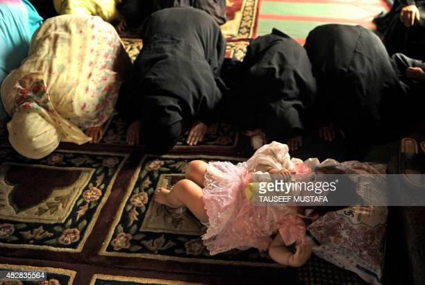 Kashmiri Muslim women attend the second Friday prayers during the Muslim holy month of Ramadan inside Kashmir's Jamia Masjid in Srinagar on August 20...