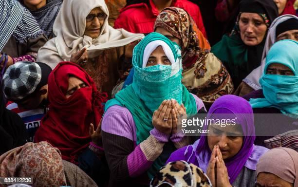 Kashmiri Muslim women devotees pray at Hazratbal shrine on the Friday following EideMilad or the birth anniversary of Prophet Mohammad on December 8...