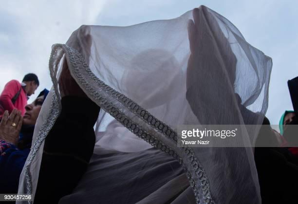 Kashmiri Muslim women devotees pray at Hazratbal shrine to mark the anniversary of Hazrat Abu Bakr Siddiq the senior companion and the fatherinlaw of...