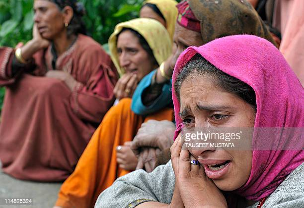 Kashmiri Muslim women mourn during the funeral of alleged Pakistanbased JaisheMohammad militants Qari Zubair and his bodyguard Muhammed Imran Khan at...
