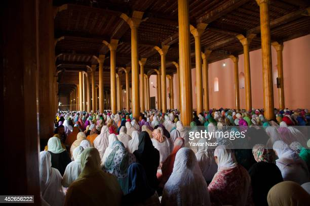 Kashmiri Muslim women offer prayers inside the Grand Mosque on the last Friday of the holy Islamic month of Ramadan on July 25 2014 in Srinagar the...
