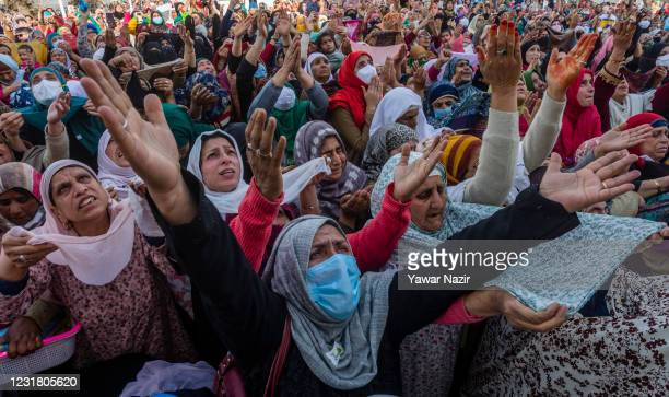 Kashmiri Muslim women pray as a Muslim cleric displays the holy relic believed to be the whisker from the beard of the Prophet Mohammed at the...