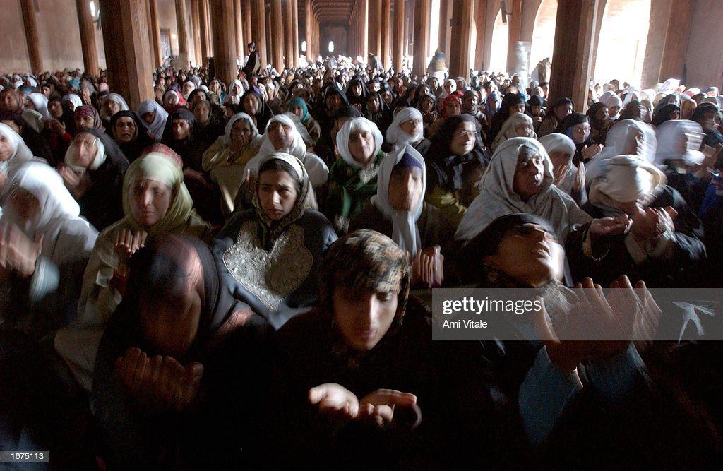 Kashmiri Muslim women pray inside Jamia Masjid on the Islamic holiday of Eid-ul-Fitr December 6, 2002 in the summer capital of Srinagar in the Indian held state of Jammu and Kashmir. The Islamic holiday of Eid-ul-Fitr is a day which culminates the Muslim month of fasting for Ramadan.