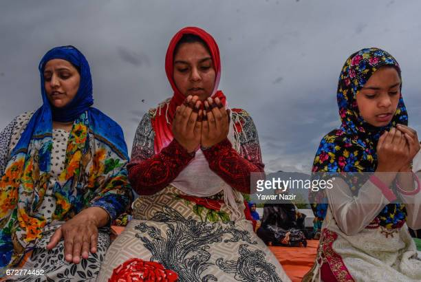 Kashmiri Muslim women pray on the occasion of the Muslim festival MehrajuAlam which marks ascension day the journey from earth to heavens of the...